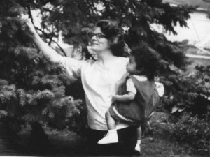 Vera and Phoebe, circa. 1964, admiring a blue spruce in the backyard.